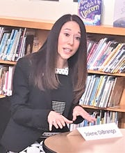 Jolene T. DiBrango, executive vice president of New York State United Teachers, discusses back state aid still owed to the Elmira City School District during a round table discussion Thursday morning at Diven Elementary School.