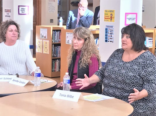 Tonia Billbe, right, a second grade teacher at Diven Elementary School in Elmira, talks about a lack of resources needed to properly educate children during a round table discussion Thursday with representatives from New York State United Teachers.