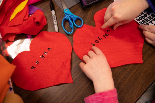 Amber Montgomery, 11, and Charity Reed, a paraprofessional, spell out Romeo and Juliet on two red, felt hearts at Lodge Community School in Evansville Wednesday afternoon, Jan. 29, 2020. They were making Valentine's Day outfits to donate to the St. Vincent Neonatal Intensive Care Unit for the babies to wear.