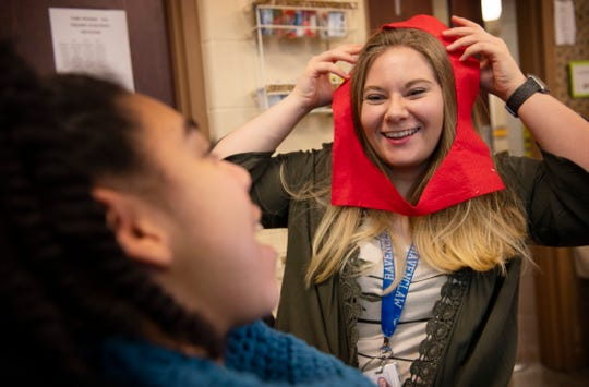 Megan Hoffman, a paraprofessional in Darla Chapman's special education class, tries (and succeeds) to get a laugh out of Kyrah Williams, 12, as they created Valentine's Day outfits for the babies at St. Vincent Neonatal Intensive Care Unit at Lodge Community School in Evansville Wednesday afternoon, Jan. 29, 2020.