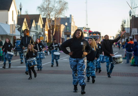 """Bre'Monyaa leads a line of dancers from Boom Squad's dance team, the Blue Diamonds, during the 2019 Evansville Christmas on North Main Parade. """"I love boom squad because they make you feel as if you're here for something,"""" she said. """"They push you to be something in your life."""""""
