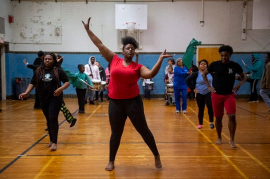 """The Blue Diamonds – with Bre'Monyaa Jones, 17, in front –  rehearse in the gym at Stanley Hall in Evansville Friday evening. """"We're like a family. I don't know where I would be without Boom Squad honestly,"""" Jones said of the dance team. """"They have given me a home."""""""