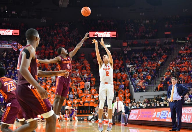 Clemson's Alex Hemenway (12) shoots over the Virginia Tech defense during their game at Clemson on Nov. 5, 2019.