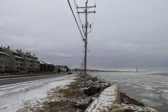 Utility poles on Lakeshore Drive in Port Clinton stand precariously close to Lake Erie. Mayor Mike Snider said one of the city's big concerns is that one of the poles could snap in a storm and rupture a sewer line, spilling raw sewage into the lake.
