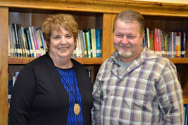 Donna Thatcher and Howie Martin met in the Sandusky County Habitat for Humanity office inside First Presbyterian Church on Jan. 28 to discuss last-minute details on the closing of Martin's home. Martin's home was the last project Thatcher worked on before retiring  as director on Jan. 31.