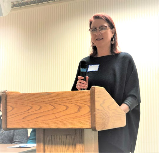 Democratic Sandusky County Candidate Holly Elder speaks at a women's issue gathering.