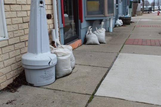 Some businesses on Jefferson Street in downtown Port Clinton have left sand bags out around their front entrances, as the city has continued to experience occasional flooding on Jefferson and Madison Streets this winter. Due to Lake Erie's record high water levels and a push from northeast winds, Port Clinton experienced more than 40 flood-related events on both streets in 2019.