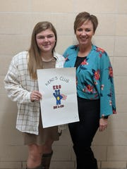 Bataan Memorial h-ERO's club shirt design winner Mattison Koskela with Bataan Memorial Primary Principal, Kendra Van Doren.