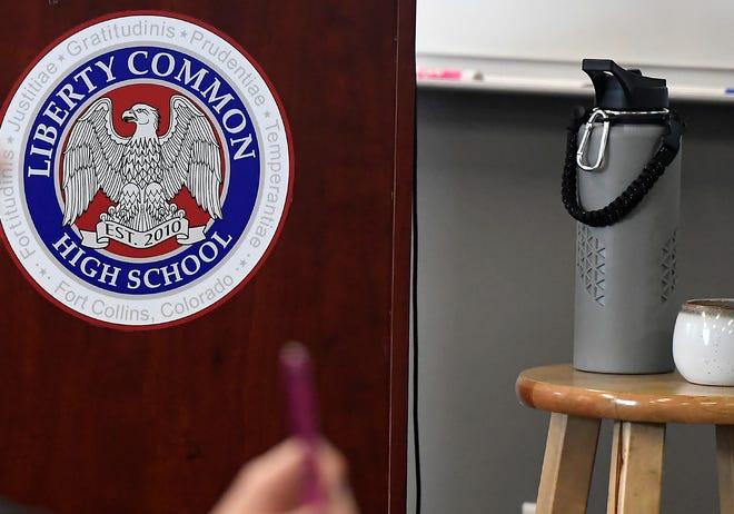 A school emblem is visible on a podium during a U.S. Secretary of Education Betsy DeVos' tour of Liberty Common High School with U.S. Rep. Ken Buck, who represents Colorado's 4th District, in Fort Collins, Colo. on Thursday, January 30, 2020.