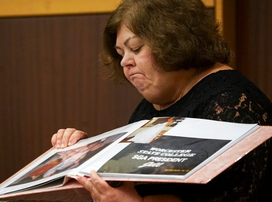 Peggy Mandeville shows photos of her daughter, Jill, during her victim impact statement on Thursday, Jan. 30, 2020, during a hearing for Brett Pelham, the teen who pleaded guilty to two charges for the crash that killed Jill.