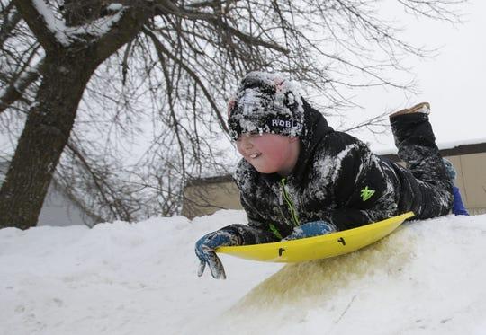 Holden Fritsche, 8, goes sledding on Tuesday in Stevens Point in 2019.
