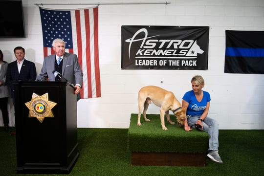 Greenville Sheriff Johnny Mack Brown introduces their new arson dog, Phoenix, who sits with trainer Christi Raak during a press conference at Astro Kennels in Simpsonville Thursday, Jan. 30, 2020.