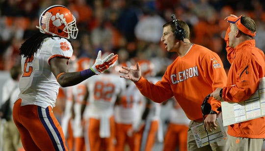Clemson wide receiver Sammy Watkins (2) and head coach Dabo Swinney during the 4th quarter of the Discover Orange Bowl at Sun Life Stadium in Miami Friday, Jan. 3, 2014. BART BOATWRIGHT/Staff