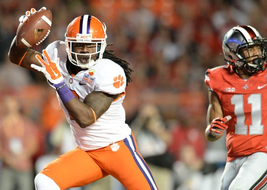Clemson wide receiver Sammy Watkins (2) catches a 34 yard TD past Ohio State defensive back Vonn Bell (11) during the 1st quarter of the Discover Orange Bowl at Sun Life Stadium in Miami Friday, Jan. 3, 2014. BART BOATWRIGHT/Staff