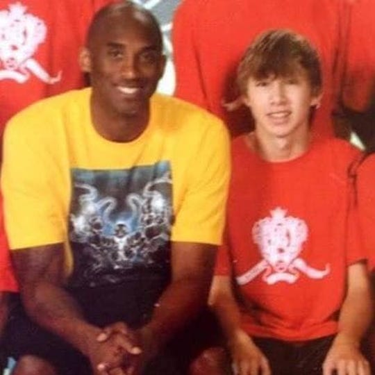 Tristan Bernard, who played basketball for Box Elder High School, poses with Kobe Bryant at a camp in California.