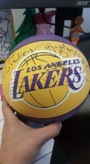 Kobe Bryant gave Lindsay Messerly a signed basketball after meeting her in 2001.