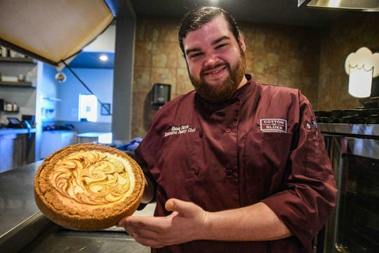 Pastry Chef Shaun Davis poses with a finished cheesecake at Cotton Blues, 6116 U.S. 98 in Hattisburg, Miss., Thursday, Jan. 30, 2020.