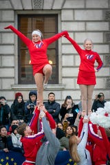 Henderson County resident Bailey Newman (left) participates in a parade in London on New Year's Day, Jan. 1, 2020.