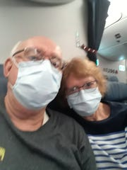 Alan and Amy Taylor's shortened excursion to China ended with a cramped 15-hour flight back to the U.S. wearing masks as a precaution against being infected by a new coronavirus that had swept across China and conceivably could have been borne by someone on the plane.