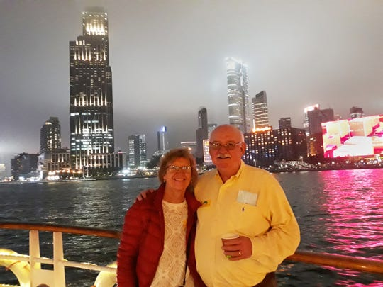 Amy and Alan Taylor pose for a photo while on a scenic cruiise on Hong Kong's harbor. When not posing for pictures, the Taylors and their Chinese friends routinely wore masks to reduce the risk of exposure to coronavirus.