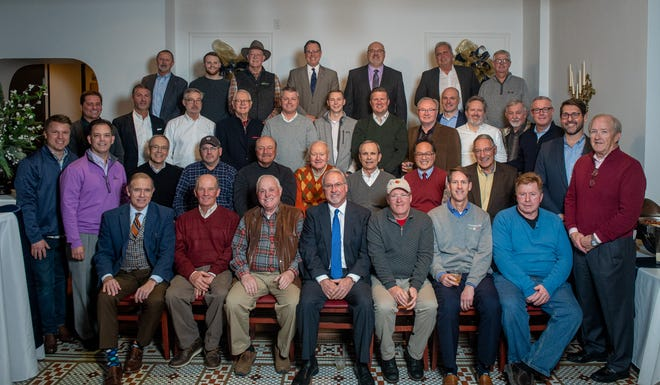 Nearly 40 members of the newly formed Men's Bourbon Society of Henderson pose for a photo in December before awarding $25,000 in gifts to seven local nonprofit organizations, including $10,000 gifts to both the Audubon Kids Zone and the Boys and Girls Club. The nonprofit organization exists to gather men for socializing, networking, supporting charitable organizations important to men and improving our community.