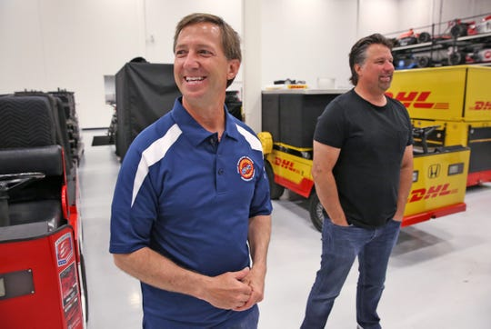 John Andretti, left, and his cousin Michael Andretti talk to Riley kids and champions, and their families, at the Andretti Autosport's shop, Monday, July 18, 2016. The Andrettis gave a tour and lunch to the visitors.