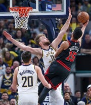 Indiana Pacers forward Domantas Sabonis (11) defends the rim against Chicago Bulls forward Chandler Hutchison (15) at Bankers Life Fieldhouse in Indianapolis on Wednesday, Jan. 29, 2020.