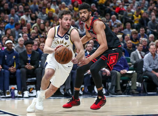 Indiana Pacers guard T.J. McConnell (9) drives along the baseline against the Chicago Bulls at Bankers Life Fieldhouse in Indianapolis on Wednesday, Jan. 29, 2020.