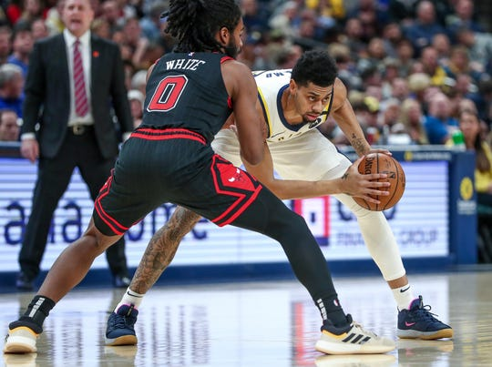 Indiana Pacers guard Jeremy Lamb (26) looks to pass inside against the Chicago Bulls at Bankers Life Fieldhouse in Indianapolis on Wednesday, Jan. 29, 2020.