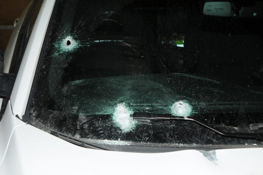 Rounds struck the windshield of a police car when Ryan McGill fired 17 shots at police on Jan. 15, 2018.