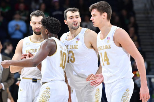 Jan 29, 2020; South Bend, Indiana, USA; Notre Dame Fighting Irish forward John Mooney (33) talks to forward Nate Laszewski (14) during a timeout in the second half against the Wake Forest Demon Deacons at the Purcell Pavilion.