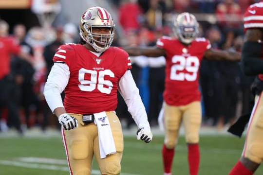 49ers defensive tackle Sheldon Day (96) reacts after the 49ers made a defensive stop against the Minnesota Vikings in the third quarter in a NFC Divisional Round playoff football game at Levi's Stadium.