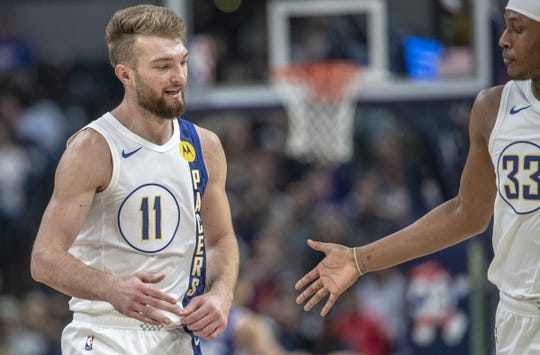 Domantas Sabonis of the Indiana Pacers gets congrats on a made shot by teammate Myles Turner, Philadelphia 76ers at Indiana Pacers, Bankers Life Fieldhouse, Indianapolis, Tuesday, Dec. 31, 2019. Indiana won 115-97 in a short game on New Year's Eve.