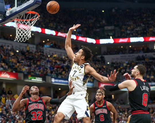 Indiana Pacers guard Malcolm Brogdon (7) gets a shot up and in against the Chicago Bulls at Bankers Life Fieldhouse in Indianapolis on Wednesday, Jan. 29, 2020.