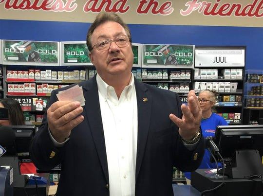Sen. Philip Moran holds two lottery tickets he bought Tuesday morning at Keith's Superstore in Pass Christian. Thursday was the first day to buy Powerball and Mega Millions in Mississippi.