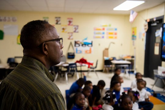 "Kindergarten teacher Jeff Davis watches during a class visit by Barbara Forest, who volunteers to read to the children once a month, at Lincoln Elementary in Jackson. ""School has taken on a role of parent, doctor, lawyer. We do it all,"" Davis said. ""We've got to make sure we're taking this thing serious."""