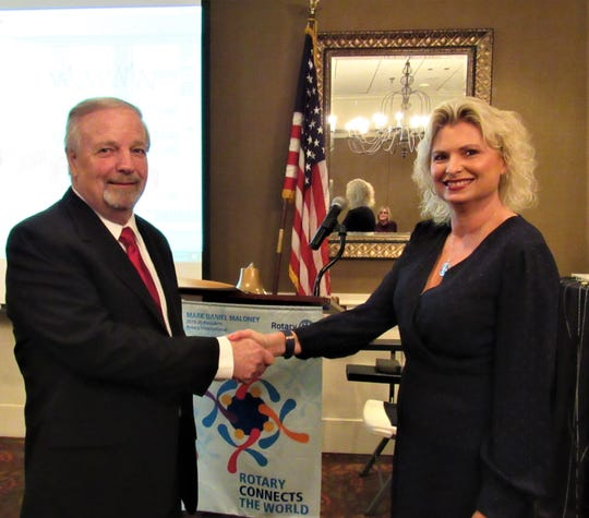 Speaker Richard Qulia was greeted by Rotary Club of Farragut President Staci Wilkerson at the meeting on Jan. 29 at Fox Den Country Club. 2020