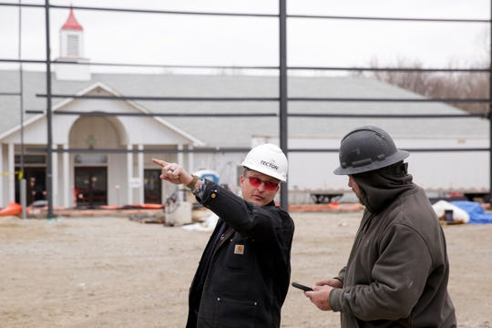 Stacy Abernathy, project manager with Tecton Construction, talks with Steve Bealmear, a project superintendent with Ziolkowski Construction, as construction continues at the Tippecanoe County Fairgrounds, Thursday, Jan. 30, 2020, in Lafayette.