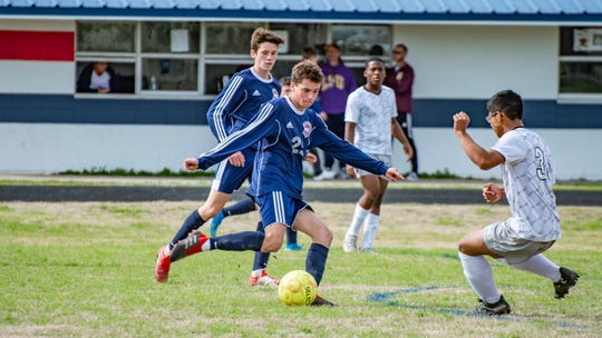 North Vermilion's Ronnie Pitre goes in to kick the ball past an Abbeville High defender Saturday, Jan. 25, 2020.