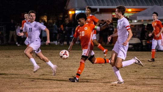Beau Chene's Adrian Eaglin (10) goes to kick the ball as the St. Thomas More Cougars face the Beau Chene Gators Tuesday, Jan. 28, 2020.