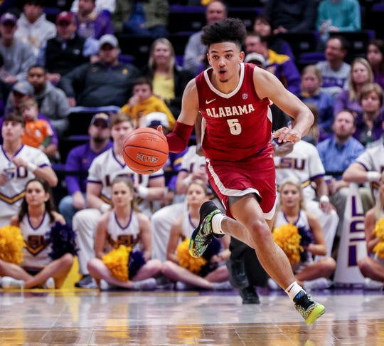 Jan 29, 2020; Baton Rouge, Louisiana, USA; Alabama Crimson Tide guard Jaden Shackelford (5) brings the ball up court against LSU Tigers in the second half at Maravich Assembly Center. Mandatory Credit: Stephen Lew-USA TODAY Sports