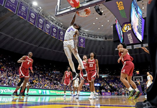 LSU forward Emmitt Williams (5) dunks the ball as Alabama defenders watch in the first half of an NCAA college basketball game, Wednesday, Jan. 29, 2020, in Baton Rouge, La. (AP Photo/Bill Feig)