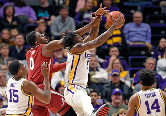 LSU forward Emmitt Williams (5) and Alabama center Javian Davis (0) battle for control of a rebound in the first half of an NCAA college basketball game, Wednesday, Jan. 29, 2020, in Baton Rouge, La. (AP Photo/Bill Feig)