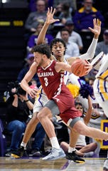 Alabama forward Alex Reese (3) drives to the basket as LSU forward Trendon Watford (2) defends in the first half of an NCAA college basketball game, Wednesday, Jan. 29, 2020, in Baton Rouge, La. (AP Photo/Bill Feig)