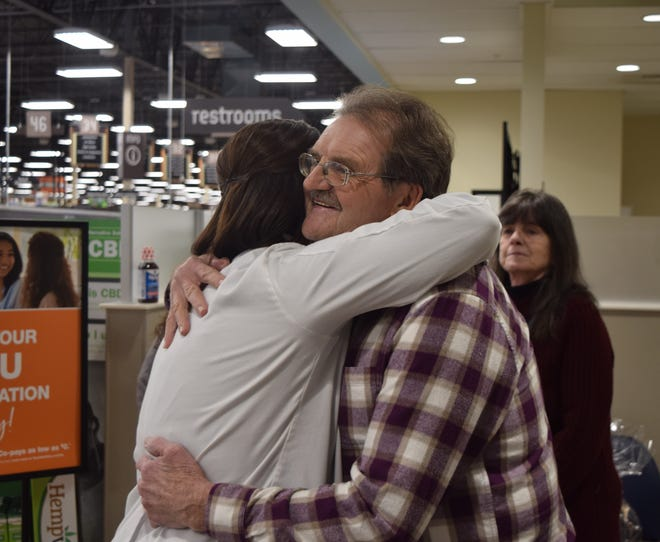 Jenn Emerson, left, hugs Jack Adams as Kay Adams looks one Jan. 29. On Jan. 15, Jack had a sudden cardiac arrest while he was in the checkout area of Kroger on Memorial Drive. Emerson was one of two medical professionals that performed CPR on Jack until firefighters could take him to the hospital.