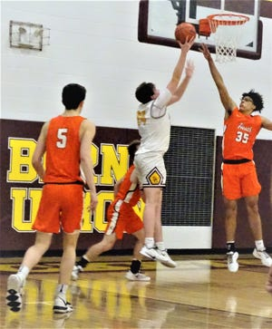 Berne Union's Brock Unger takes a shot inisde over Heath's Keylan Williams during the Bulldogs' 57-49 win Wednesday night.