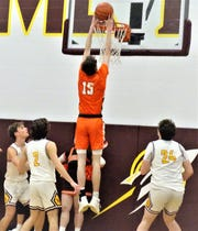 Heath's Nate Langley goes up for a dunk to record the Bulldogs' final two points of the game in a 57-49 win over host Berne Union Wednesday night.