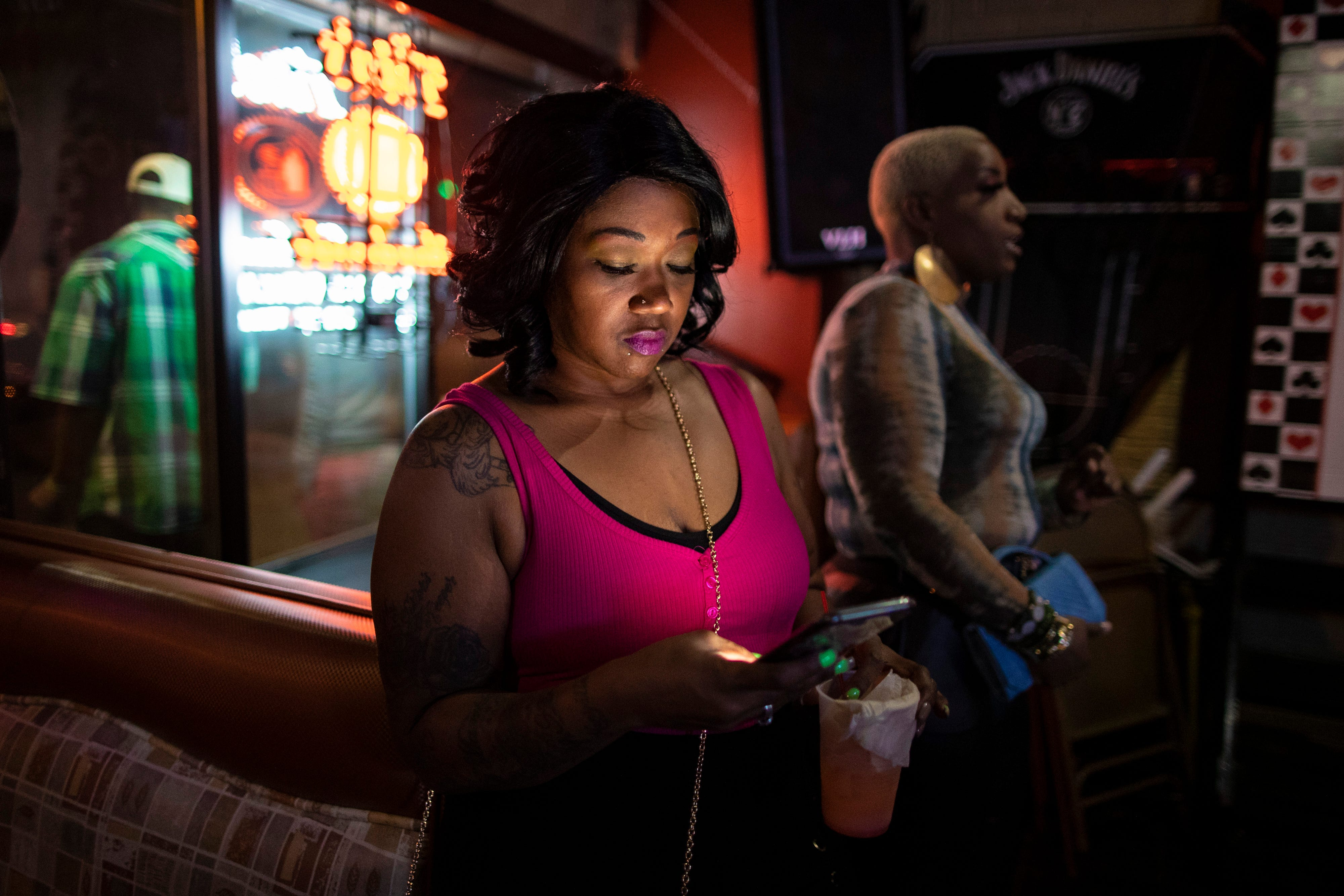 3:03 AMKenyatta Polen, left, scrolls through social media on her phone at Double Deuce's on West Broadway while her friend Chiquita Minor dances to the music on  Jan. 26, 2020. The west end establishment is a popular night spot for late night dancing on the weekends.