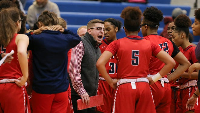 Butler head coach Wyatt Foust instructed his team against Bullitt East during a timeout in the LIT at Valley High School in Louisville, Ky. on Jan. 29, 2020.