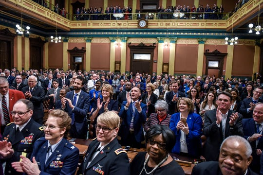 People applaud as Michigan Gov. Gretchen Whitmer delivers her State of the State address on Wednesday, Jan. 29, 2020, at the Michigan State Capitol in Lansing.